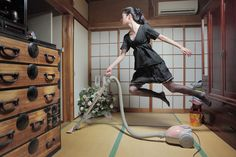 Japanese photographer Natsumi Hayashi glides through Tokyo without ever really touching her feet to the ground. At least that's what it seems in her Levitation photographs where Hayashi floats along in otherwise ordinary scenes.