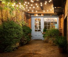"""24 Jaw Dropping Beautiful Yard and Patio String Lighting Ideas For a Small Heaven - """"Freemans"""" restaurant in NYC at the end of Freeman Alley, off Rivington, between The Bowery and Christie. Backyard Lighting, Patio Lighting, Landscape Lighting, Lighting Ideas, Lighting Design, Outdoor String Lighting, Wall Lighting, Exterior Lighting, Restaurant En Plein Air"""
