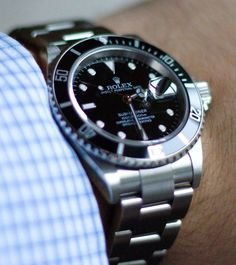 My Rolex Submariner. Bought in 2008, this is a late Z series without the engraved rehaut. Four years on, it's still remarkably accurate and a joy to wear and own.