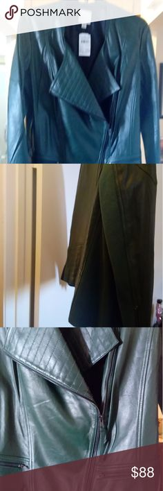 """Sejour real leather moto style jacket Your friends will be forest green with envy if you show up to an event wearing this leather jacket!  100% leather outer material mixed with 100% cotton ribbing and 100% polyester lining.  Zipper front with zipper sleeve and pocket details.  Professional leather clean care. Approximate measurements:. Bust: 48"""", Waist: 41.5""""and Length:26"""".  NWT:. Never been worn but original tags state altered or refinished.  No damage ,rips or tears. Sejour Jackets…"""