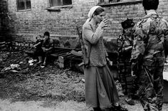 Chechen rebels during Russia's first war in Chechnya. 1996. The young woman carries a 7.62x39mm AKM.