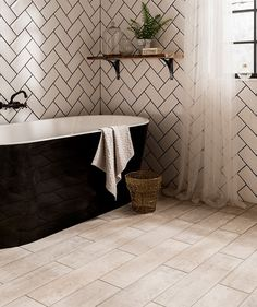 Cornish Driftwood™ http://www.toppstiles.co.uk/tprod45452/cornish-driftwood-light-tile.html  These beautiful tiles have been inspired by washed out rustic wood reclaimed from old beach huts and shipwrecks along the Cornish coast.