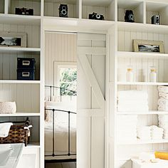 Coastal Collections Highlight antique keepsakes like cameras or typewriters by placing them on white-painted built-in bookshelves. Enhance the vintage feel with black-and-white photographs.