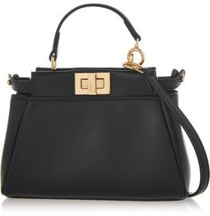 Fendi - Peekaboo Micro Leather Shoulder Bag - Black - A miniature version of the iconic 'Peekaboo', Fendi's bag is perfect for evenings out. This supple black style is finished with polished gold-tone hardware and unlocks to reveal two compact compartments fitted with card slots. Go hands-free with the optional shoulder strap, or attach it to your tote as a playful charm.