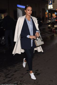 She means business! Jessica Alba went for the androgynous look as she stepped out in Paris...