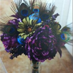 The PERFECT peacock bouquet. Or take out the peacock feathers and you've got a bouquet that would work for an elegant wedding too. :)