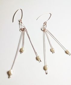 Sterling Silver Rose Gold Fresh Water Pearl Dangle Earrings by JujusNature on Etsy