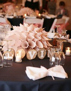 Show me your paper decor! :  wedding decor diy Round Paper cylinder like vases to hold flowers-vintage like-cream and lace with pearls. Travel with sheets flat and put together in Mexico.