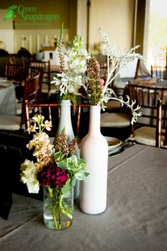 Winery Wedding Centerpieces | High-low centerpiece arrangement including wine bottle vases with wax ...