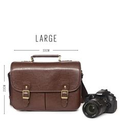 New Dark Brown Camera Bag With Handle - Large. This vintage style leather look satchel in Large will comfortably fit your DSLR camera, a spare lens and your personal junk. Your camera will be well protected with padded inner cushioning. Perfect for: the casual photographer, the traveller or the fashion conscious. No more leaving your DSLR behind, and no more ugly camera bags.