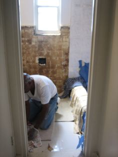 Renovating the bathroom DIY style... we peeled the old tiles off the wall. What u see as brown is the wall waiting to be retiled.