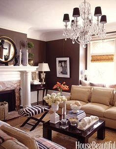 The chocolate wall adds so much warmth to this room.  I love small, cozy livingrooms.
