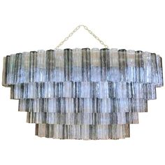 Large Oval Mid-Century Murano Tronchi Chandelier by Zuccheri for Venini | From a unique collection of antique and modern chandeliers and pendants at https://www.1stdibs.com/furniture/lighting/chandeliers-pendant-lights/