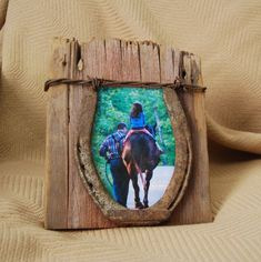 Reclaimed barn wood photo and horse shoe picture frame. 4 X 6 with rusty horse shoe and barbed wire.