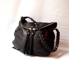 A personal favorite from my Etsy shop https://www.etsy.com/listing/519042551/alberta-bag-in-black-braided-handle
