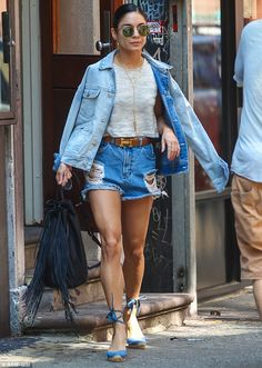 Double denim darling! Vanessa Hudgens rocked denim cut-offs and a denim jacket draped over...