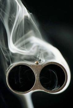 Smoking double barrel shotgun