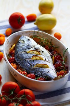 Oven baked fish with tomatoes, rosemary and lemon Oven Baked Fish, Fish Soup, Tasty, Yummy Food, Fish And Seafood, Cherry Tomatoes, Tray Bakes, Lemon, Stuffed Peppers
