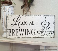 LOVE IS BREWING  How sweet is this...a self standing LOVE IS BREWING sign! This elegant little sign is done in distressed & aged VINTAGE SOFT IVORY with aged BLACK lettering, and is 5.5 high x 11.5 long. Perfect sign for your COFFEE or BEER BAR........or even for your SAVE THE DATE pictures! IMPORTANT NOTE: This sign stands perfectly simply by inserting the dowel (included at no charge) into the hole that we add at the center back bottom. (See picture) Hammer it in for a tight fit. The dowel…