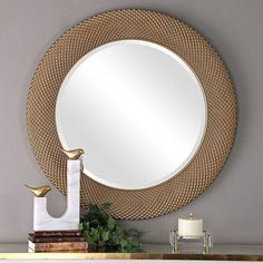 This decorative piece has a curved surface featuring an embossed repeating design with textured beaded details, finished in a metallic gold with a taupe gray glaze. Mirror features a generous 1 bevel. W X 35 H X 1 D (in) Sunburst Mirror, Round Wall Mirror, Floor Mirror, Round Mirrors, Mirror Glass, Uttermost Mirrors, Mirrors Wayfair, Mirror Shop, Contemporary Wall Mirrors