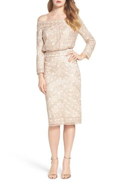 Shimmering sequins illuminate the lacy texture of this lovely party dress that showcases the shoulders.