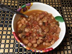 This pinto bean soup is a super easy crock pot meal that freezes well and is easy to make into different meals.