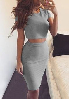 Girl in a grey two-piece skirt set taking a selfie