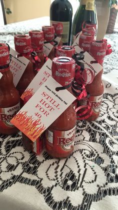 40th birthday favors! Too hot for 40. Hot sauce, hot tamales, and a nip of fireball whiskey!