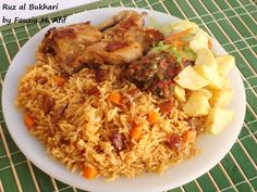 Bukhari Rice (known in Arabic as Ruz al Bukhari) is a Saudi Arabian speciality (some say it is Afghani by origin).  It is by far one of my favourite Arabic meals and is a fragrant flavourful rice dish normally served with roast chicken (Dajaj).  I usually serve this dish with Salata Hara (a fresh and spicy tomato sauce), some chopped fresh salad and a small side of fried potato cubes (because we certainly love potatoes in my home!)  :)