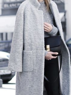 long light grey wool coat | large pockets | minimal, modern | clean lines, chic | + dark grey top | light grey pants | small black Celine handbag | fall fashion | street style