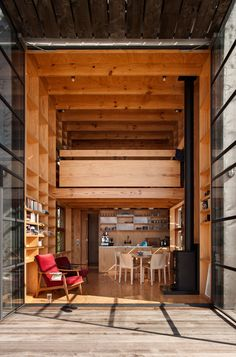 The Hut on Sleds is a beach house designed by New Zealand architecture firm Crosson, Clarke, Carnachan Architects. Modern Tiny House, Tiny House Design, New Zealand Architecture, Architecture Design, Cheap Building Materials, New Zealand Beach, Timber Cladding, Small Buildings, Building A House
