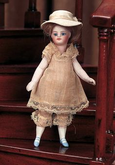View Catalog Item - Theriault's Antique Doll Auctions - french all bisque with original costume and bonnet, 5""