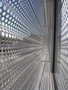 The undulating aluminum sunscreen on Wykagyl Shopping Center's new upper level.