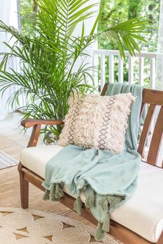 Boho Summer Back Porch - Bless'er House A tropical boho back porch decorated for summer with breezy, functional style from Walmart's Flower Home line by Drew Barrymore and string lights for evening ambience. #backporch #summerdecor