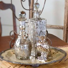 Putrid Potion Arrangement  -  Add some toil and trouble to your Halloween display by grouping antique perfume bottles on a bronze serving platter to look like magic potions.