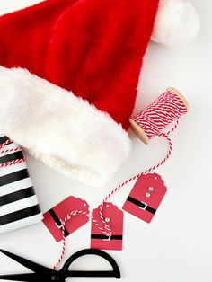 Kids and grown-ups alike will love these Santa suit gift tags. To pull off these DIY Christmas tags you'll need red and black card stock, glitter card stock and adhesive gems like rhinestones…