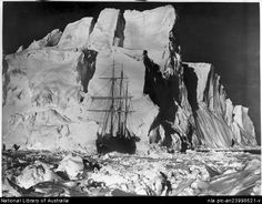 Hurley, Frank, 1885-1962. A mighty iceberg ploughed its way through the pack and bore down upon the imprisoned ship [Worsley, Wordie and the Endurance, Shackleton expedition, 1914-1917] [picture] : [Antarctica]
