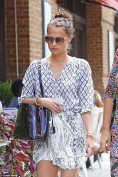 Shady lady: Alicia covered her fresh face with a pair of oversized shades, while her locks...