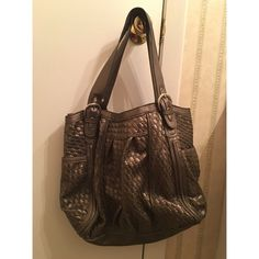 Poppie Jones purse the color is hard to describe. it's like a weird bronze color. two outside pockets on each side. zipper closing. great condition. no trades. Poppie Jones Bags Totes