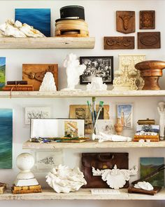 Brooke and Steve Giannetti's Ojai estate, Patina Farm, exudes timeworn warmth — even though it has just been built. || Plaster fragments, painting supplies and other items occupy shelving created from scaffolding.