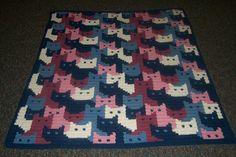 Cats Afghan free pattern here: https://web.archive.org/web/20121205054236/http://mypages.iit.edu/~veltjes/cats_afghan.pdf