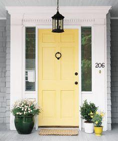 gray house, white trim,yellow front door