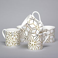 Alfred & Wilde's lovely bone china mugs! hand-decorated in Stoke-on-Trent with 9 carat gold. The gold geometric patterns are based on the Platonic Solids.