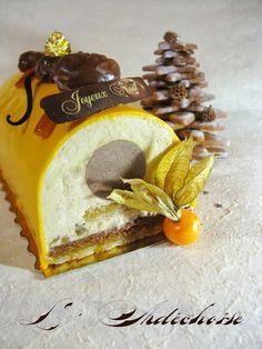L'Ardéchoise (dacquoise amandes/orange, feuilletine praliné, crémeux chocolat/marrons, mousse aux marrons & brisures de marrons glacés, glaçage miroir à l'orange)