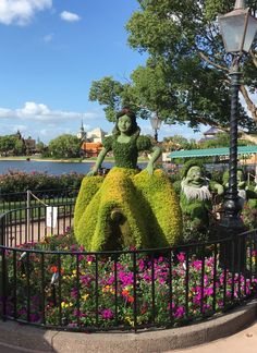Snow White and her Dwarfs march along next the the World Showcase Lagoon. Epcot's International Flower and Garden Festival