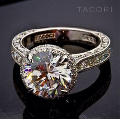 In love with this brilliant round diamond engagement ring!