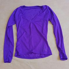 Long Sleeve Purple V-neck Long sleeve work out v neck. Keeps you fresh by letting air come in through small openings in shirt. Shapes around your body. Size is unknown but I am an S and picture 2 shows how it fits. Not really lulu, just posted for viewing. lululemon athletica Tops Sweatshirts & Hoodies