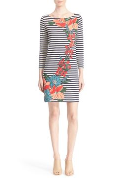 Crisp stripes and an arching column of painterly blossoms create a sweet-yet-sophisticated vibe on this charming T-shirt dress by Tory Burch.