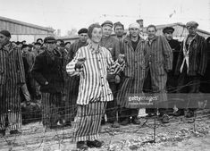 1945 In Photos. Part I A Hungarian Jewish boy in his prison suit of blue and white stripes smiles over the barbed wire at Dachau concentraion Camp. He was expecting to be gassed in a few days time and now is saved. (Photo by Horace Abrahams/Getty Images). Jewish History, Second World, Weird World, World War Two, Historical Photos, Prison, Wwii, Germany, Blue And White