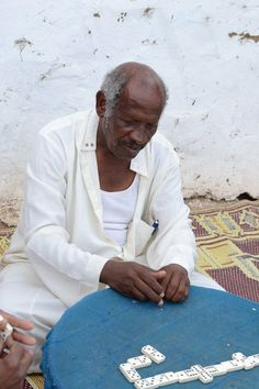 Nubian old man playing dominos
